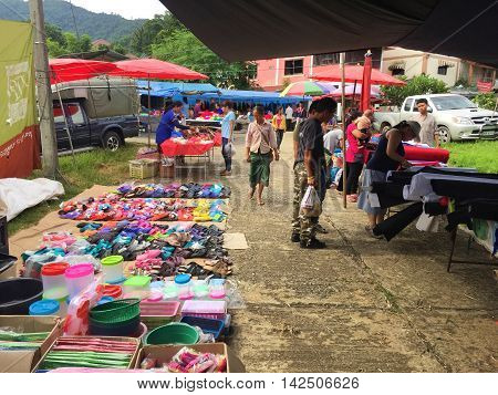 CHIANG RAI THAILAND - AUGUST 9 : horizontal photo of unidentified people are in a market at the Thai-Laos frontier on August 9 2016 in Chiang rai Thailand. This is one of travel attraction in Chiang Rai.