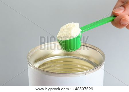 Preparing baby milk formula on light background