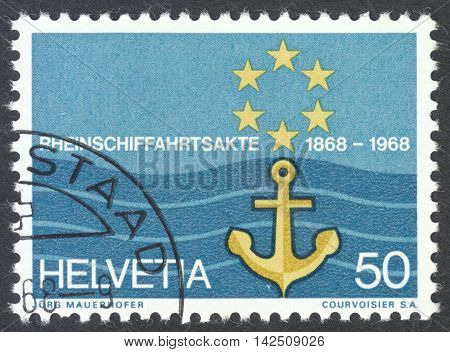 MOSCOW RUSSIA - CIRCA APRIL 2016: a post stamp printed in SWITZERLAND shows flag of Rhine Navigation Committee circa 1968