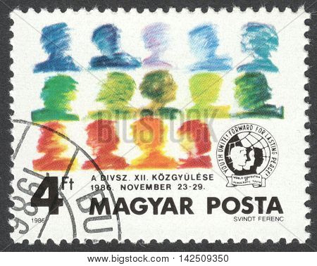 MOSCOW RUSSIA - CIRCA APRIL 2016: a post stamp printed in HUNGARY dedicated to the General Assembly of Democratic Youth Association circa 1986