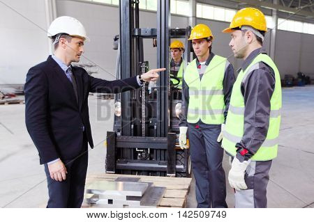 Workers And Loader In Factory