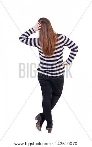 back view of standing young beautiful  woman.  girl  watching. Rear view people collection.  backside view of person. Girl in a striped jacket thoughtfully scratching his head.