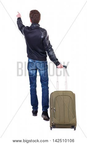 back view of  pointing man  with suitcase. brunette guy pointing .  backside view of person.  Rear view people collection. Isolated over white background. Traveller indicates hand away.