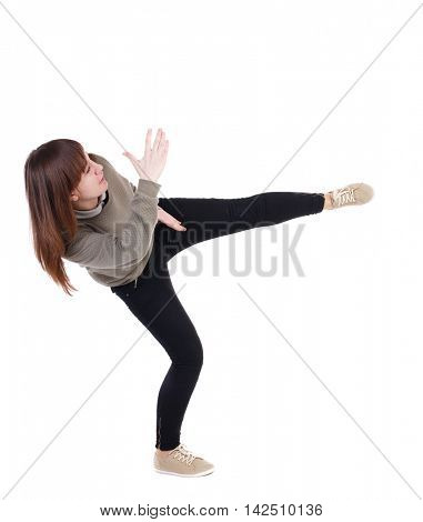 back view of woman funny fights waving his arms and legs. Rear view people collection. backside view of person.  Isolated over white background. A girl in a gray sweater has foot.
