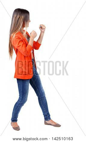 back view of woman funny fights waving his arms and legs. Rear view people collection. backside view of person.  Isolated over white background.  student in a red jacket in a boxing rack.