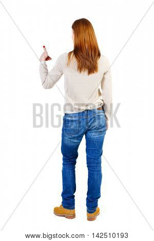 Back view of  woman thumbs up. Rear view people collection. backside view of person. Isolated over white background. The girl in a white warm sweater shows left hand thumb up.