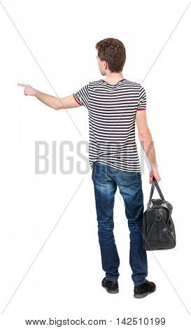 back view of  pointing man  with bag.  backside view of person.  Rear view people collection. Isolated over white background. Curly boy in a striped vest holding a bag in his hand and shows up finger.