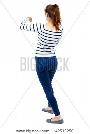 back view of woman funny fights waving his arms and legs. Rear view people collection. backside view of person.  Isolated over white background. The girl in the striped sweater is back and fighting.