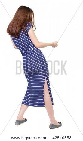 back view of standing girl pulling a rope from the top or cling to something. girl  watching. Rear view people collection.  backside view of person.  Isolated over white background. The brunette in a