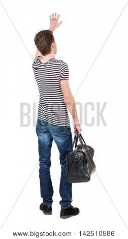 back view of  man with a bag waving in greeting.  backside view of person.  Rear view people collection. Isolated over white background. Curly boy in a striped vest holding a bag in his hand and