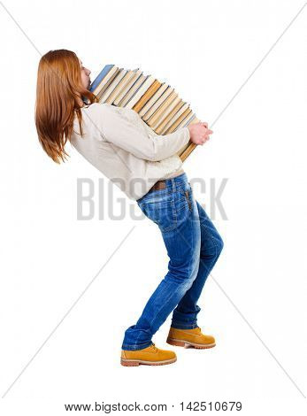 Girl carries a heavy pile of books. back view.  Rear view people collection.  backside view of person.  Isolated over white background. Blonde in a white blouse strongly leaned back under the weight