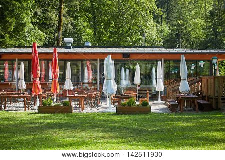 Closed Parasols At The Terrace Of A Restaurant At Lake Langbathsee In Austria, Salzkammergut