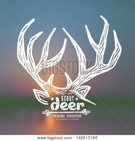 Graphic design for t-shirt with a image of deer horns. White print on blurred background