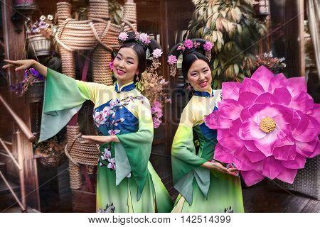 portrait of asian women with floral parasol