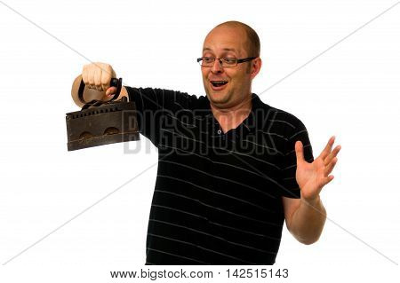 Funny amazed man in glasses and causial shirt holding old rusty iron isolated on white background