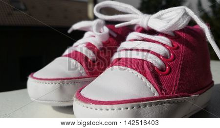pair of sports pink shoes for baby