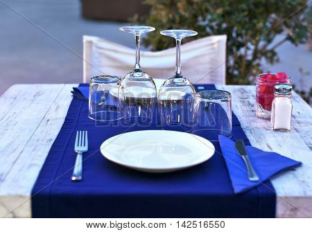 Dinner table setting in the evening. Dinner for two.