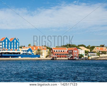 Blue and Orange Buildings on Curacao by channel