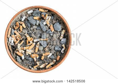 Ashtray of cigarette made of terra cotta. Isolated on white background with copy space