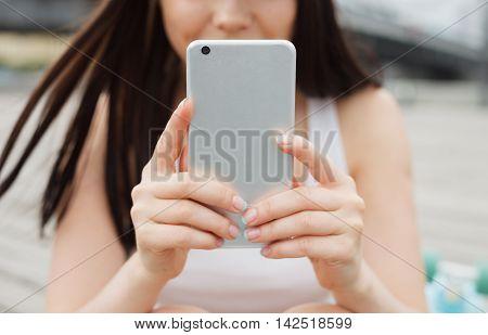 Girl Using Big Modern Phablet Smartphone With Dual Camera