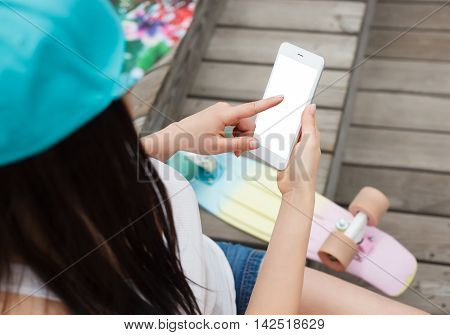 Girl Using Big Modern Phablet Smartphone With Blank Screen