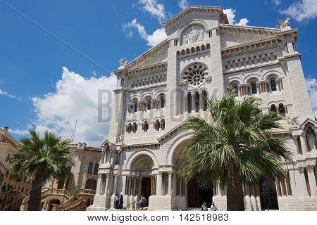 MONACO, MONACO - JUNE 17, 2015: Exterior of the Monaco Cathedral (Cathedrale de Monaco) in Monaco-Ville, Monaco. It's famous for the tombs of Princess Grace and Prince Rainier.