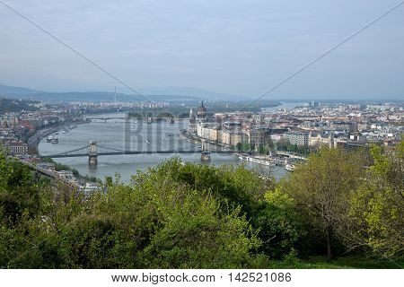 River Danube in Budapest Hungary with riverbanks and ships