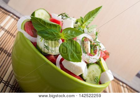 View Closeup On A Green Bowl With A Useful Salad