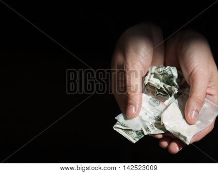 drug trafficking, crime, addiction and sale concept - close up of addict hands with drugs and money