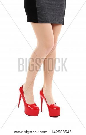 Female Legs With Red High Heels On A White Background