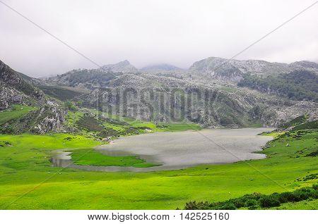 Breathtaking view of the small lake in the Picos de Europa mountains. Asturias. Spain.