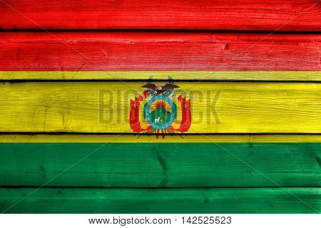 Flag Of Bolivia With Coat Of Arms, Painted On Old Wood Plank Background