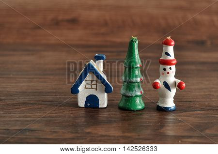 Figurines to decorate a Christmas tree isolated on a wooden background