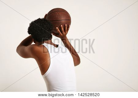 Young Black Athlete Throwing A Basketball