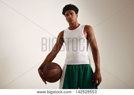 Low Angle Shot Of A Black Model With  Leather Basketball
