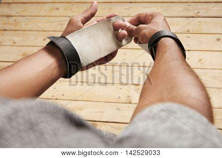 Black Athlete Putting On Gymnastics Hand Protection