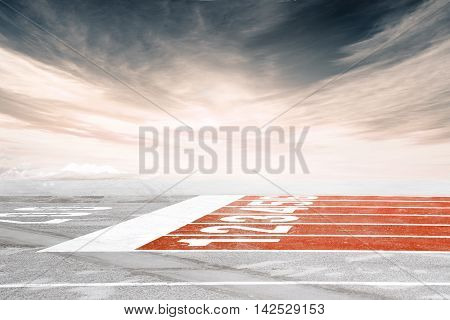 Empty Track Finish Line Against Dramatic Cloudy Sky