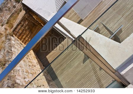architecture detail of decking and glass outside in sun
