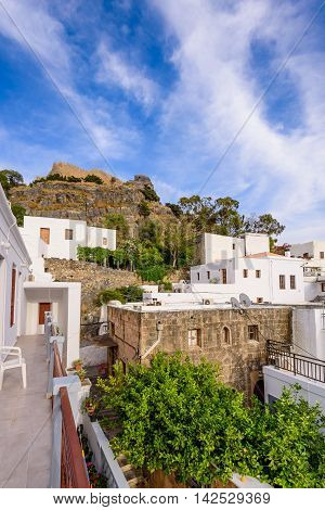 Rhodes island, Dodecanese, Greece - May 19, 2016: View of the picturesque village of Lindos with its traditional white houses.