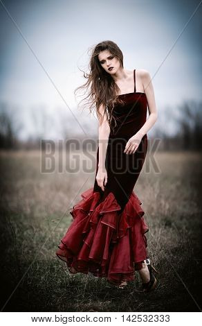 A beautiful sad young woman in the field