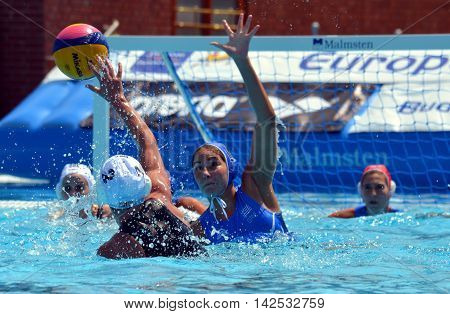 Budapest, Hungary - Jul 16, 2014. WILCOX Chloe (GBR, 2) and PLEVRITOU Eleftheria  (GRE, 11). The Waterpolo European Championship was held in Alfred Hajos Swimming Centre in 2014.