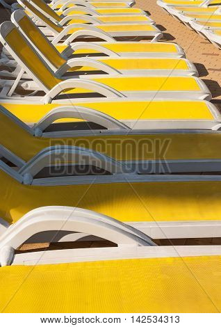 Close-up sunbeds to enjoy the tourists of the sun and good weather. Summer holiday