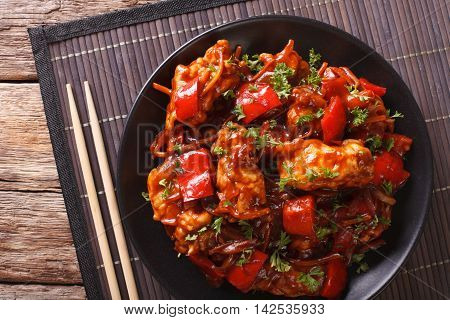 Asian Food: Spicy Pork In Sweet And Sour Sauce Close-up. Horizontal Top View