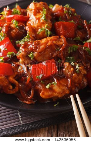 Pork In Sweet And Sour Sauce With Peppers, Carrots And Onions Macro. Vertical