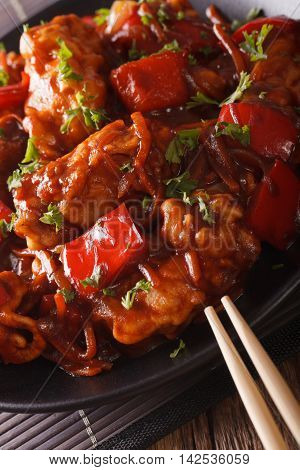 Pork Braised In Sweet And Sour Sauce With Vegetables Close-up. Vertical
