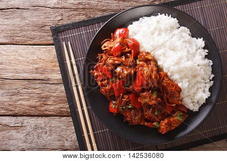 Chinese Food: Pork In Sweet And Sour Sauce With Rice Close-up. Horizontal Top View