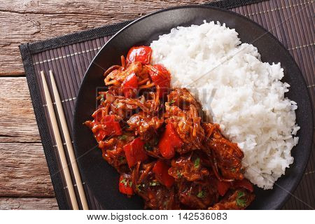 Rice With Stewed Pork In Sweet And Sour Sauce Closeup. Horizontal Top View