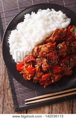 Rice With Stewed Pork In Sweet And Sour Sauce Closeup. Vertical Top View