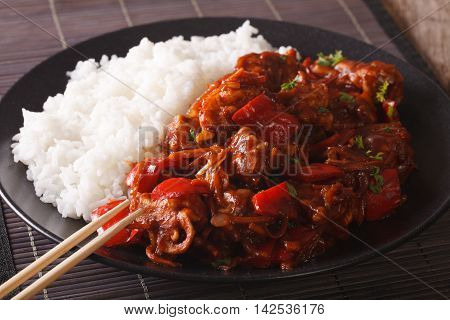Asian Cuisine: Rice With Pork In Sweet And Sour Sauce Closeup. Horizontal