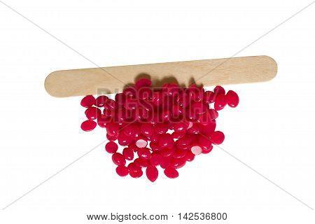 long stick wood insulation wax pellets, on a white background